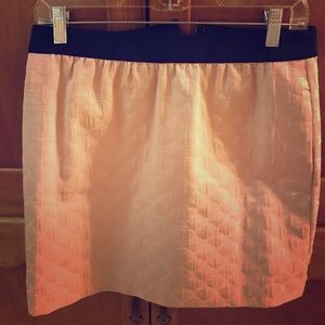 Pale pink skirt with black waistband.