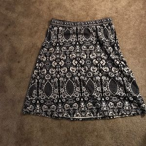 Black , white and gray below the knee skirt.