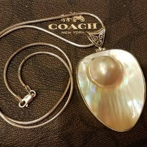 Mabe pearl with mother of pearl inlay in Sterling