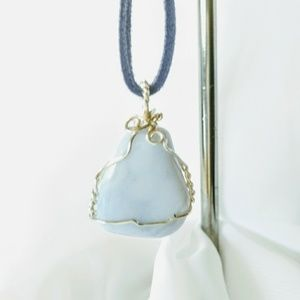 Wire Wrapped SP Blue lace agate pendant.