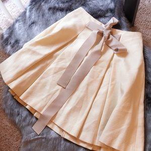 Crolla Cream bow tie pleated skirt.