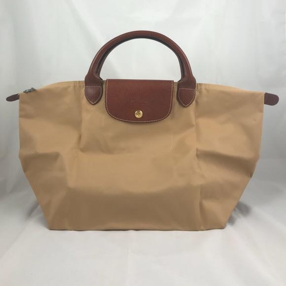 67224ab10af9 Longchamp Handbags - Longchamp Le Pliage Top-Handle Tote - Medium