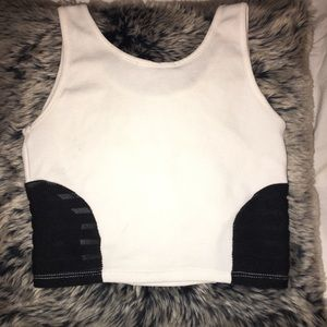 White crop top. Black mesh sides