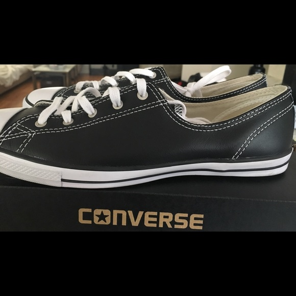 Black with white stitching Converse.