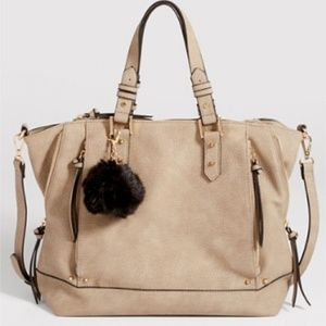 Pebbled faux leather tote with fur ball
