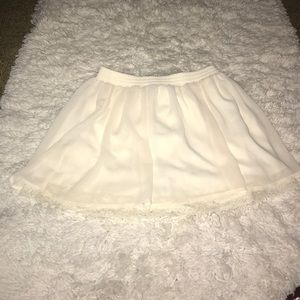 Cream skirt with a slit lace under neath
