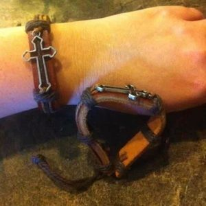 Brown faux leather bracelet with cross.