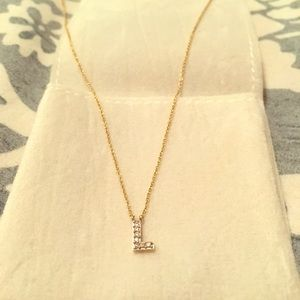 """COVET by Stella & Dot yellow gold """"L"""" necklace."""