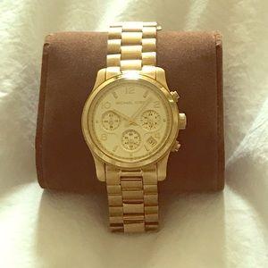 Michael Kors Women's Gold Watch in worn condition