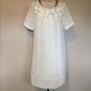 Flowy Cream Dress With Rosette Embellishments