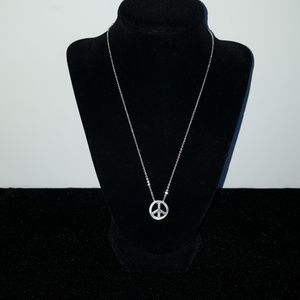 Silver tone peace sign necklace