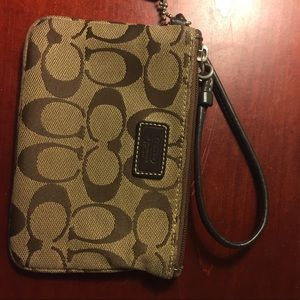 COACH wristlet with brown leather