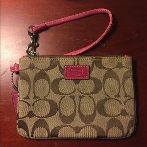 COACH wristlet with pink leather