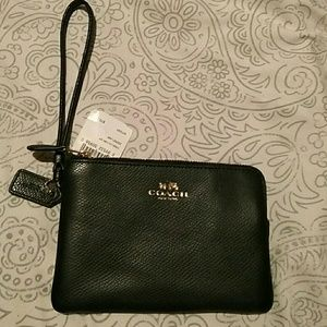 Small authentic wristlet black coach