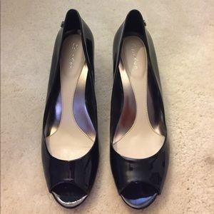 Black patent leather peep toe pumps