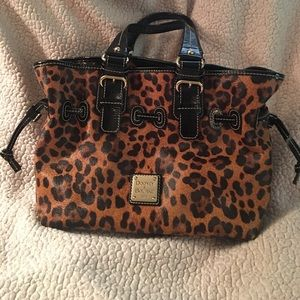Matching Dooney leopard purse and wallet set .