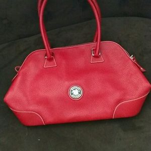 Ladies red leather Dooney and Bourke purse.