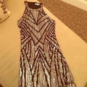 Parker sequined cocktail dress in gold.