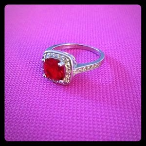 Red stone with halo ring