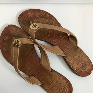 Tory Burch luggage color leather flip flops.