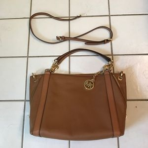 Michael kors bag with crossbody strap.