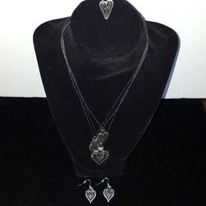 Silver and leatherette necklace and earring set