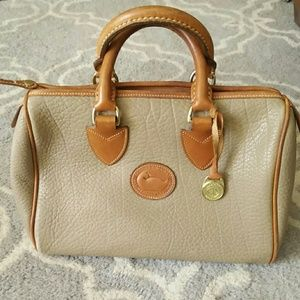 Dooney & Bourke pebbled beige and tan hand bag