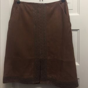 Suede skirt with grommet detail