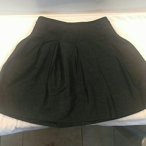 Pleated black denim Gap skirt.
