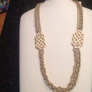 Lia Sophia three chain gold statement necklace.