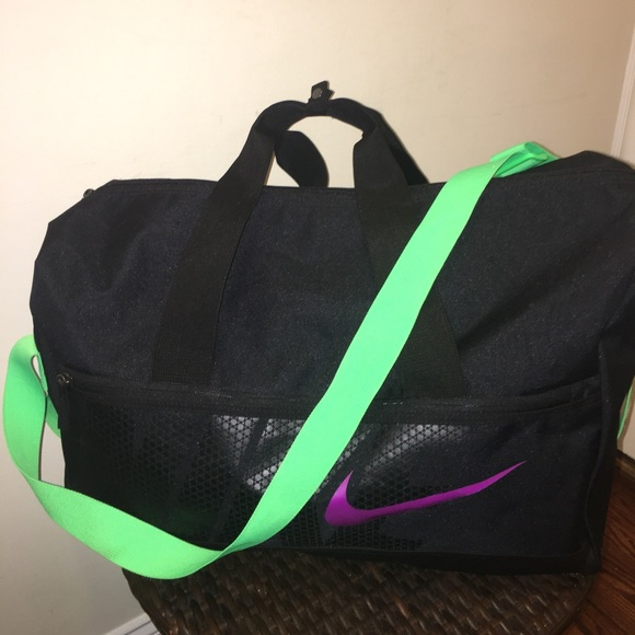 Black Nike duffel bag with neon accents! M 59eb9fffbf6df5a78804aea2 77d159fefa6b6