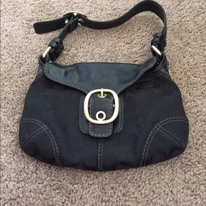 Black coach bag with dust bag
