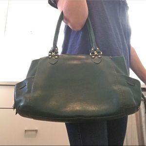 Cole Haan green leather tote handbag orange liner
