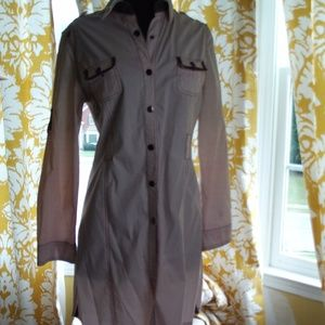 Pale pink dress with military attributes