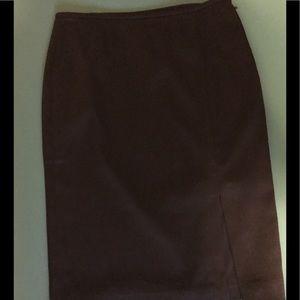 Skirt straight lined. Satin Black look.