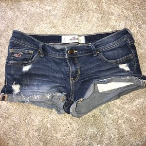 Distressed dark jean shorts
