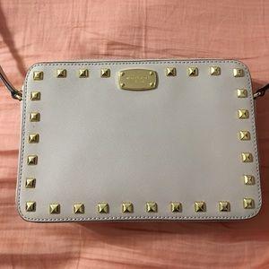 Michael Kors purse. Tan with studs. Small damage