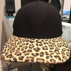 Black cap with long leopard print bill