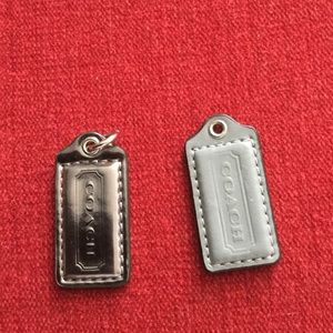 Coach two small hand tags in grey color no chain