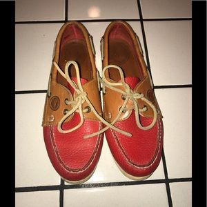 Dooney & Bourke red and tan boat shoes.