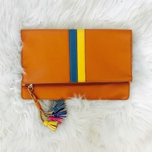 Color block stripe tassel clutch.
