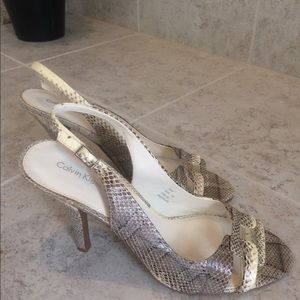 Calvin Klein snake skin heels.