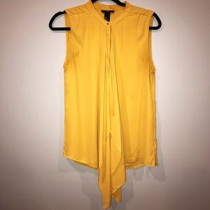 Yellow flowing front tank top
