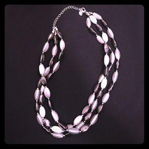 Alfani multi strand necklace.