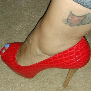 Red open toe crock patent leather heels.