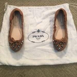 Prada flats mauve colored with stud and bow detail