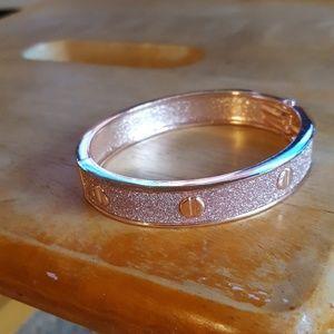 Rose gold bracelet.
