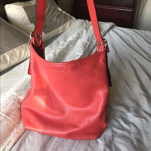 Coach legacy duffle bucket bag in carnelian