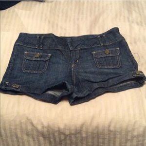 Bebe denim shorts with gold stitching