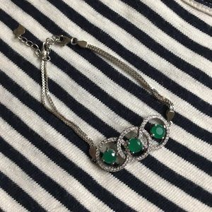 Silver bracelet with green stones